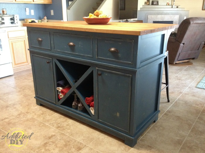 Diy kitchen island addicted 2 diy for Build kitchen island with cabinets