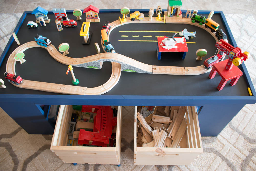 This table is perfect for keeping the kids entertained!  It can be used as a train table, a Lego table, drawing, and more!  It is the perfect DIY gift idea for Christmas!