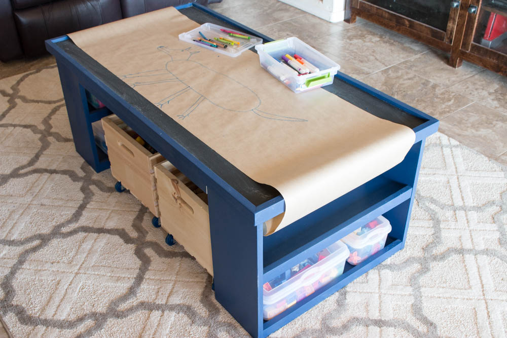 This table is perfect for keeping the kids entertained!  It can be used as a train table, a Lego table, drawing, and more!  Plus there's loads of storage space!  It is the perfect DIY gift idea for Christmas!