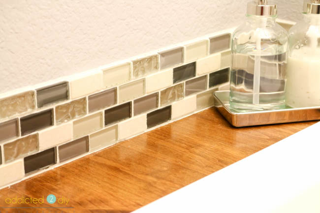 mosaic tile backsplash in bathroom