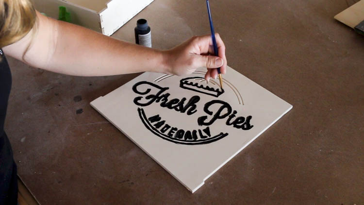Painting The Design On A Pie Box