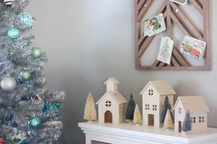 to go along with the mid century modern look i made these tiny wooden houses i left them the natural wood color which helped them to contrast against the - Mid Century Modern Christmas Tree