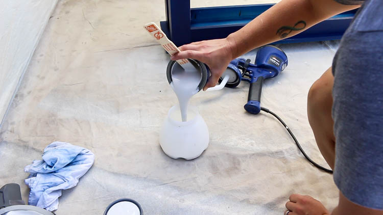 pour paint into sprayer