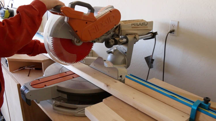 cutting lumber with miter saw