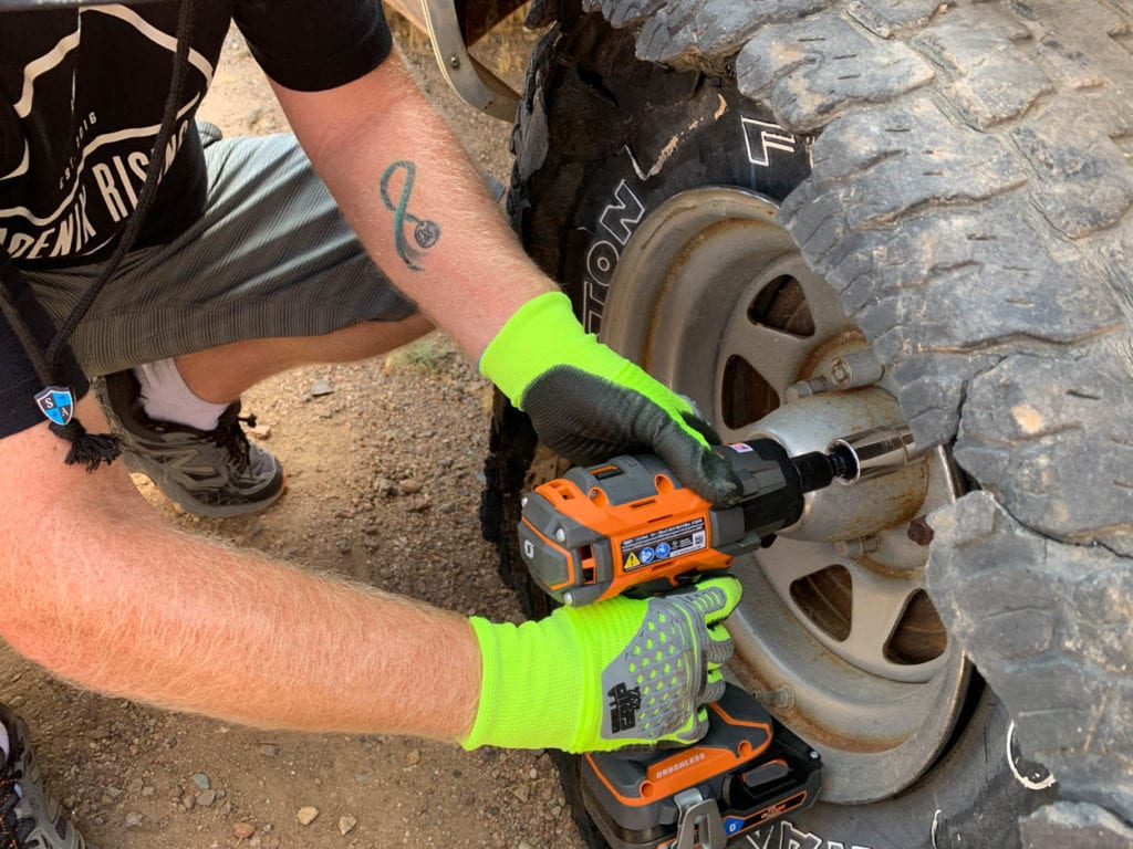 Loosening lug nuts with impact wrench