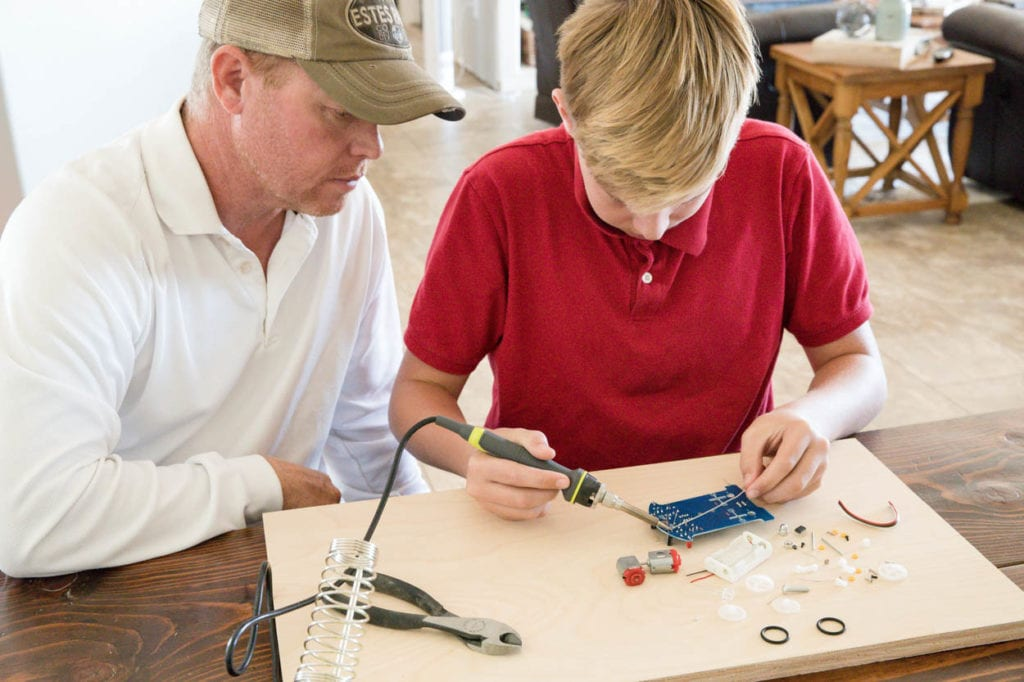 13 year old soldering a smart car project