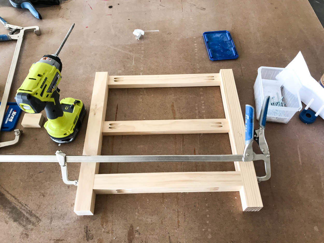 building the outside legs of the storage bench