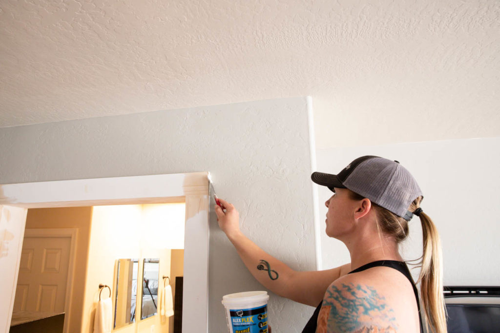 applying spackle to trim