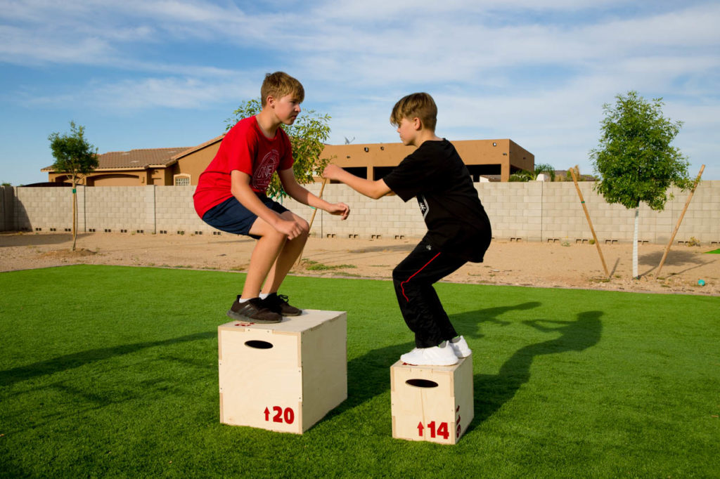 jumping on plyometric box